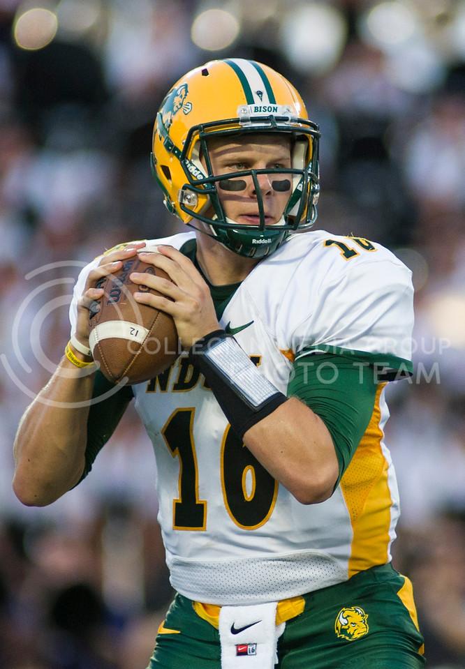 (Photo by Emily DeShazer / The Collegian)<br /> North Dakota State quarterback Brock Jensen looks downfield Friday night at Bill Snyder Family Stadium.