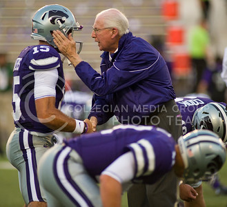 (Photo by Emily DeShazer / The Collegian) K-State quarterback Jake Waters (left) listens to Bill Snyders words of advice before kickoff against Norht Dakota State Aug. 30, 2013 at Bill Snyder Family Stadium.