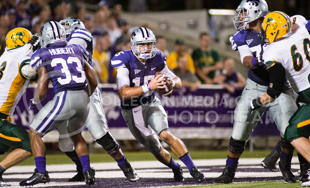(Photo by Emily DeShazer / The Collegian)<br /> Quarterback Jake Waters brings the ball out of his own endzone during the game against North Dakota State on Aug. 30, 2013.