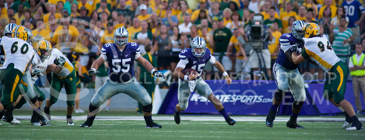 (Photo by Emily DeShazer / The Collegian)<br /> K-State quarterback Jake Waters rushes through a hole in the defense Friday night at Bill Snyder Family Stadium.