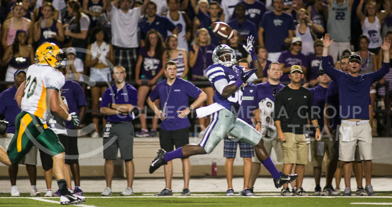 (Photo by Emily DeShazer / The Collegian)<br /> K-State wide receiver Tramaine Thompson catches a touchdown pass from Jake Waters Aug. 30 2013 at Bill Snyder Family Stadium.