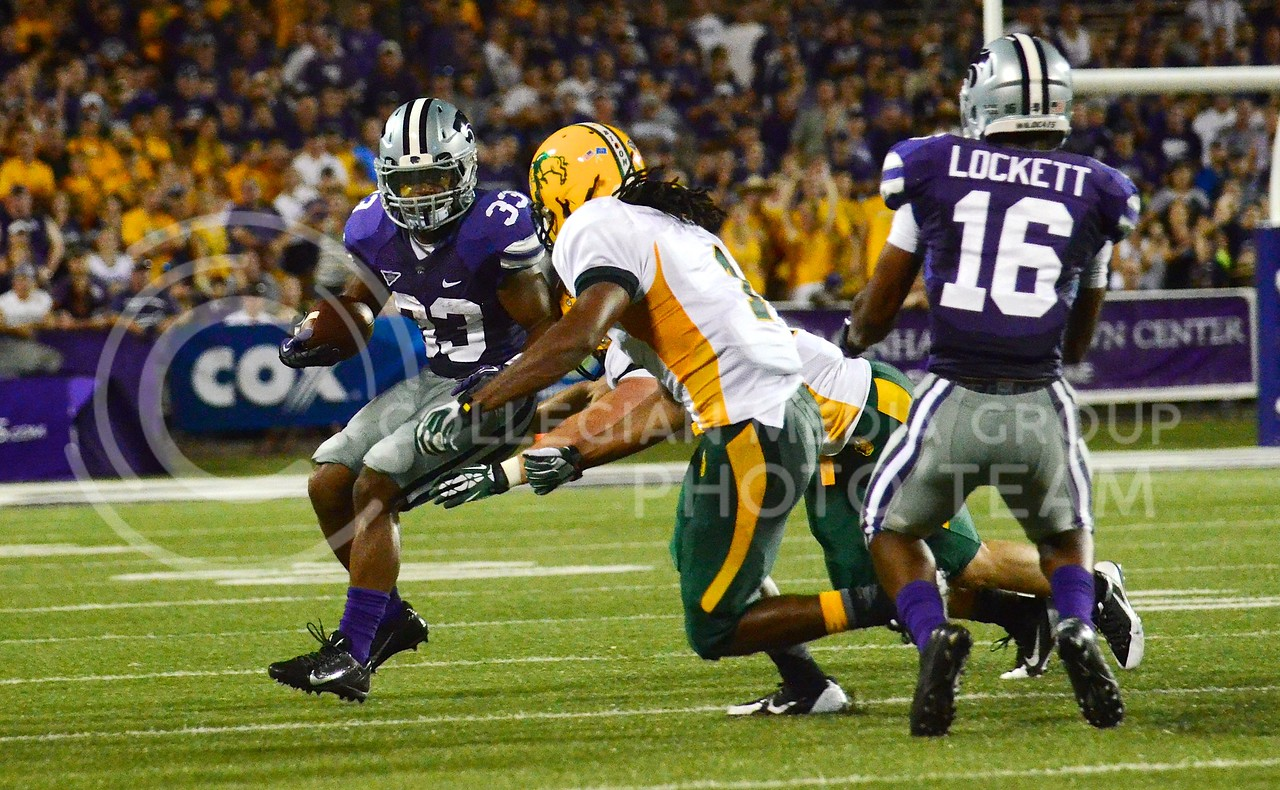 (Photo by Parker Robb | Collegian)<br /> <br /> Senior running back John Hubert attempts to evade a tackle during the second quarter of the Wildcats' season opener 21-24 loss to the North Dakota State Bison August 30.