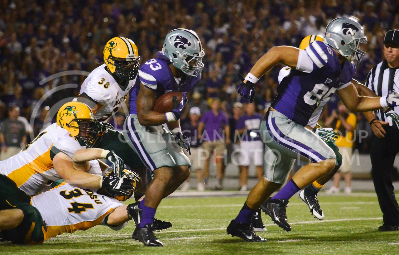 (Photo by Parker Robb | Collegian)<br /> <br /> Senior running back John Hubert, evading three tacklers, rushes for 17 yards and a K-State first down behind blocking junior tight end Zach Trujillo during the second quarter of the Wildcats' season opener 21-24 loss to the North Dakota State Bison August 30.