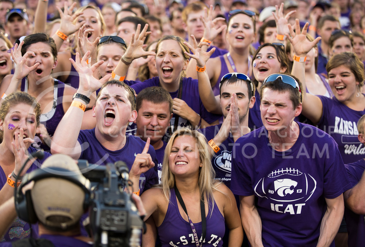 K-State fans show their spirit for the video camera at the KSU vs NDSU game in BSFS on Aug. 30, 2013.
