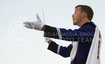 (Photo by Emily DeShazer / The Collegian) A drum major directs the K-State band before the game against North Dakota State on Aug. 30, 2013 at Bill Snyder Family Stadium.
