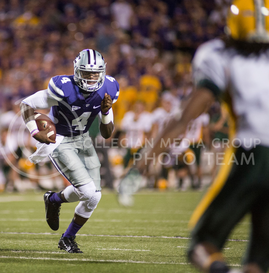 (Photo by Emily DeShazer / The Collegian)<br /> Quarterback Danniel Sams rushes in for a touchdown while alluding the North Dakota State defense Aug. 30, 2013 at Bill Snyder Family Stadium.
