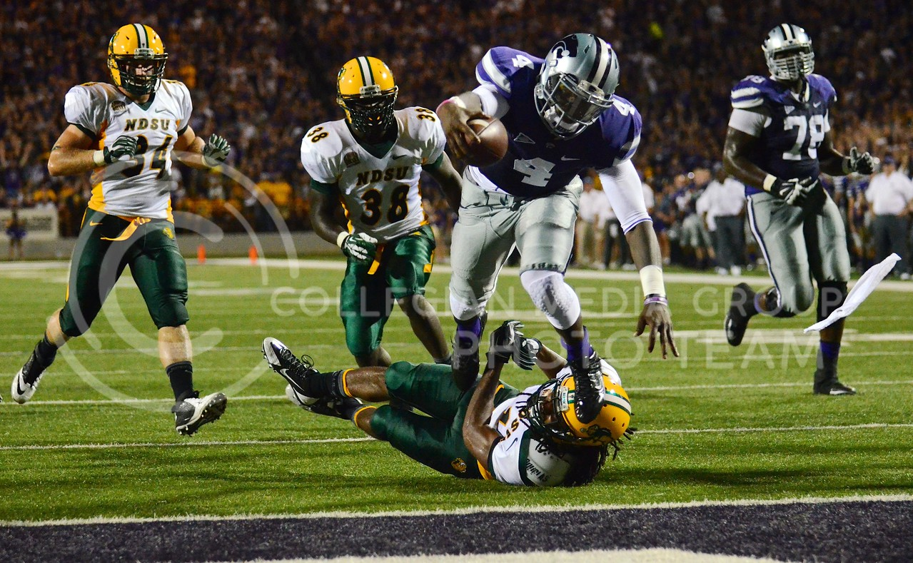 (Photo by Parker Robb | Collegian)<br /> <br /> Redshirt sophomore quarterback Daniel Sams, after a 17 yard run, stumbles over a missed tackle and into the end zone for K-State's third touchdown during the third quarter of the Wildcats' season opener 21-24 loss to the North Dakota State Bison August 30.