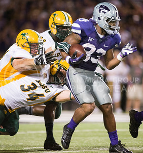 (Photo by Emily DeShazer / The Collegian) K-State running back John Hubert avoids three North Dakota State defenders on Aug. 30, 2013.