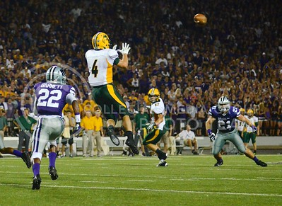 (Photo by Parker Robb | Collegian)  North Dakota State wide receiver Ryan Smith springs up to catch a pass from quarterback Brock Jensen during the second quarter of the Wildcats' season opener 21-24 loss to the North Dakota State Bison August 30.