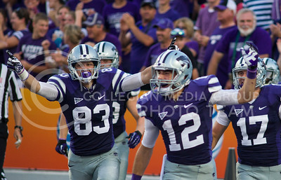 (Photo by Emily DeShazer / The Collegian)   The special teams kickoff return team celebrate after Tramaine Thompson took one back to the house Aug. 7, 2013 at Bill Snyder Family Stadium.