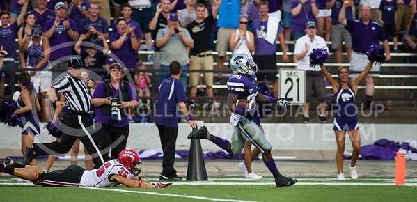 Tramaine Thompson returns a kickoff 94 yards for a touchdown Aug. 7, 2013 at Bill Snyder Family Stadium.