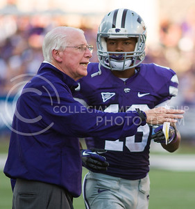 (Photo by Emily DeShazer / The Collegian)   Head coach Bill Snyder speaks to junior wide receiver Tyler Lockett on Aug. 7, 2013 at Bill Snyder Family Stadium.