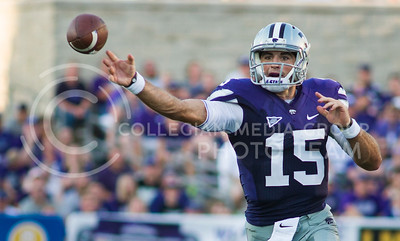 (Photo by Emily DeShazer / The Collegian)   Junior K-State quarterback Jake waters throws downfield on Aug. 7, 2013 at Bill Snyder Family Stadium.