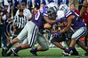 (Photo by Emily DeShazer / The Collegian) K-State senior linebacker Blake Slaughter receives help from his teammates to bring down UMass running back Stacey Bedell.