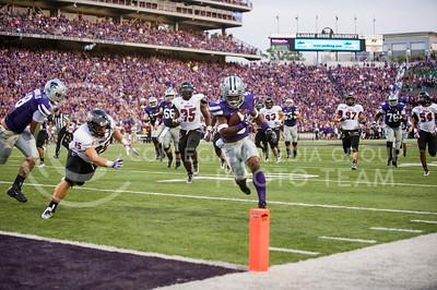 (Photo by Emily DeShazer / The Collegian) Senior running back Robert Rose rushes for a touchdown on Sept. 14, 2013 at Bill Snyder Family Stadium.