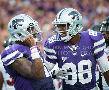 (Photo by Emily DeShazer / The Collegian) Sophomore quarterback Daniel Sams celebrates a rushing touchdown with senior wide receiver Torell Miller on Sept. 14, 2013 at Bill Snyder Family Stadium.