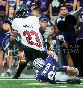 (Photo by Emily DeShazer / The Collegian) K-State junior linebacker Jonathan Truman  holds on to UMass running back Stacey Bedell on Sept. 14, 2013 at Bill Snyder Family Stadium.