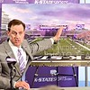 Parker Robb | The Collegian<br /> <br /> Athletic Director John Currie points out features and answers questions about the newly-announced Bill Snyder Family Stadium Phase III expansion involving a complete demolishment and rebuilding of the Vanier Football Complex and north end of the stadium, which will wrap around to close off the bowl of the stadium, during a press conference at halftime of the Spring Game April 26, 2014. The new Vanier Complex will also include a new academic learning center, olympic-sized weight room, hydrotherapy pools, and a snack bar, all of which will be available to all student athletes.