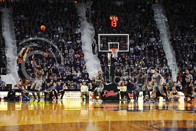 (Photo by Parker Robb | Collegian)  Junior forward Nino Williams defends a three point shot by Oklahoma State guard Markel Brown in the first half of the Wildcats' 74-71 upset victory over the #6-ranked Oklahoma State Cowboys in Bramlage Coliseum January 4, 2014.