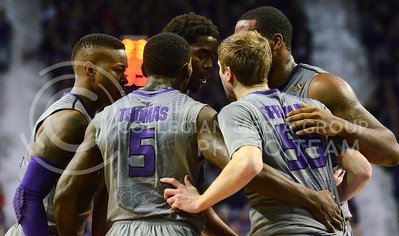 (Photo by Parker Robb | Collegian)  The Wildcats huddle after an Oklahoma State foul to plan their next attack in the first half of the Wildcats' 74-71 upset victory over the #6-ranked Oklahoma State Cowboys in Bramlage Coliseum January 4, 2014. The upset victory did not come easy, with a total of 49 fouls being committed by both teams, and senior guard Shane Southwell fouled out in the crucial moments of the game.