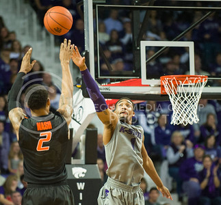 (Photo by Emily DeShazer | Collegian)  K-State senior guard Shane Southwell defends a shot by Oklahoma State junior Le'Bryan Nash on Jan. 4 in Bramlage Coliseum to open conference play.