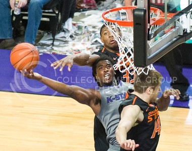 (Photo by Emily DeShazer | Collegian)  K-State junior forward Nino Williams lifts up a shot around Oklahoma State's Marcus Smart outstretched arm on Jan. 4, at Bramlage Coliseum.