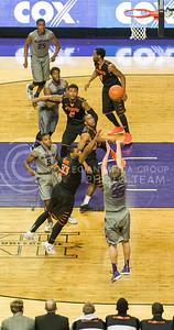 (Photo by Emily DeShazer | Collegian)  K-State senior guard Will Spradling sends up a 3-pointer over No. 6 Oklahoma State on Jan. 4 at Bramlage Coliseum.