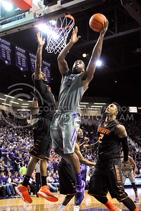 (Photo by Parker Robb | Collegian)  Junior forward Thomas Gipson jumps for a layup in the second half of the Wildcats' 74-71 upset victory over the #6-ranked Oklahoma State Cowboys in Bramlage Coliseum January 4, 2014.