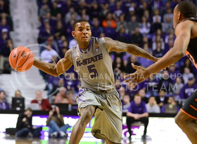 (Photo by Parker Robb | Collegian)  Freshman guard Jevon Thomas passes the ball to a teammate in the first half of the Wildcats' 74-71 upset victory over the #6-ranked Oklahoma State Cowboys in Bramlage Coliseum January 4, 2014.