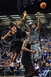 (Photo by Parker Robb | Collegian)  Junior forward Thomas Gipson attempts to take a shot while the ball is tipped out of his hand by Oklahoma State guard Markel Brown in the first half of the Wildcats' 74-71 upset victory over the #6-ranked Oklahoma State Cowboys in Bramlage Coliseum January 4, 2014.