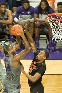 (Photo by Emily DeShazer | Collegian)  K-State junior forward Thomas Gipson drives to the basket over Oklahoma State sophomore forward Kamari Murphy on Jan. 4, at Bramlage Coliseum.