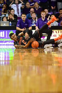 (Photo by Parker Robb | Collegian)  Oklahoma State guard Le'Bryan Nash slides across the floor after a slight nudge from a K-State player in the first half of the Wildcats' 74-71 upset victory over the #6-ranked Oklahoma State Cowboys in Bramlage Coliseum January 4, 2014.