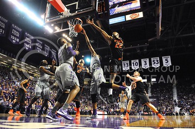(Photo by Parker Robb | Collegian)  K-State and Oklahoma State players reach for a rebound in the second half of the Wildcats' 74-71 upset victory over the #6-ranked Oklahoma State Cowboys in Bramlage Coliseum January 4, 2014.
