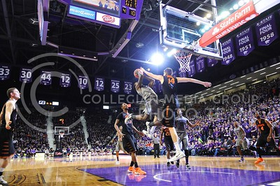 (Photo by Parker Robb | Collegian)  Freshman guard Jevon Thomas soars for a shot against OSU forward Marek Soucek in the final seconds of the first half of the Wildcats' 74-71 upset victory over the #6-ranked Oklahoma State Cowboys in Bramlage Coliseum January 4, 2014.