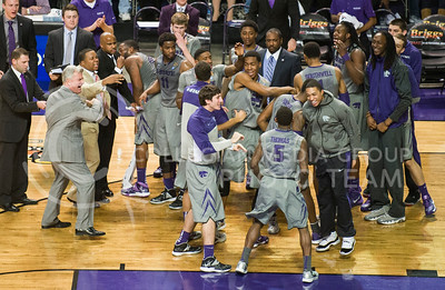 (Photo by Emily DeShazer | Collegian)  K-State players and coaches celebrate after taking the lead late in the second half against No. 6 Oklahoma State on Jan. 4, at Bramlage Coliseum.