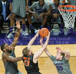 (Photo by Emily DeShazer | Collegian)  K-State junior forward Thomas Gipson and senior guard Will Spradling defend a shot by Oklahoma State sophomore guard Phil Forte on Jan. 4, at Bramlage Coliseum.