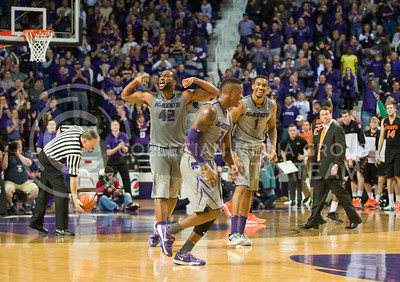 (Photo by Emily DeShazer | Collegian)  K-State junior forward Thomas Gipson flexes his muscles during the 74-71 win over No. 6 Oklahoma State on Jan. 4, at Bramlage Coliseum.