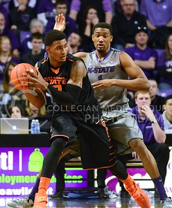 (Photo by Parker Robb | Collegian)  Oklahoma State guard Le'Bryan Nash tries to advance the ball past senior guard Shane Southwell in the first half of the Wildcats' 74-71 upset victory over the #6-ranked Oklahoma State Cowboys in Bramlage Coliseum January 4, 2014.