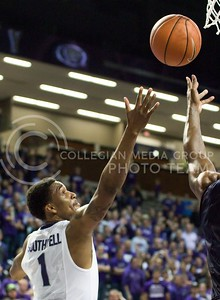 Photo by Jed Barker | The Collegian  Senior guard Shayne Southwell attempts to get the rebound against North Colorado at Bramlage Coliseum on November 8, 2013.