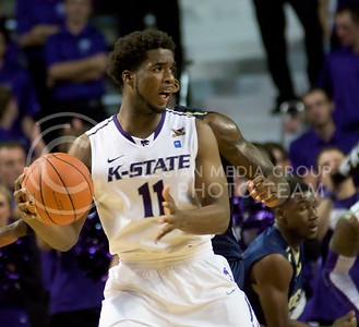 Photo by Jed Barker | The Collegian  Junior forward Nino Williams looks to pass the ball during the game against North Colorado at Bramlage Coliseum on November 8, 2013.