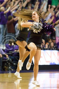 Photo by Jed Barker | The Collegian  A K-State cheerleader spins around during her routine at the men's basketball game against North Colorado at Bramlage Coliseum on November 8, 2013.