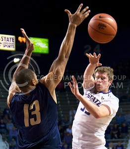 Photo by Jed Barker | The Collegian  Senior guard Will Spradling passes the ball during the game against Northern Colorado at Bramlage Coliseum on November 8, 2013.