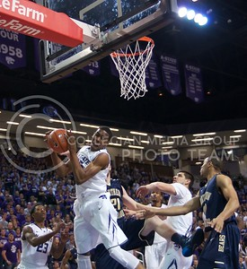 Photo by Jed Barker | The Collegian  Freshman guard Wesley Iwundu gets the rebound against North Colorado at Bramlage Coliseum on November 8, 2013.