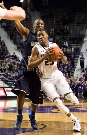 Photo by Jed Barker | The Collegian  Freshman guard Wesley Iwundu drives past North Colorado forward Tim Husskison at Bramlage Coliseum on November 8, 2013.