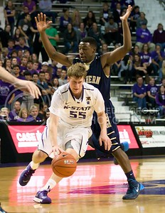Photo by Jed Barker | The Collegian  Senior guard Will Spradling dribbles past North Colorado's Jordan Wilson at Bramlage Coliseum on November 8, 2013.