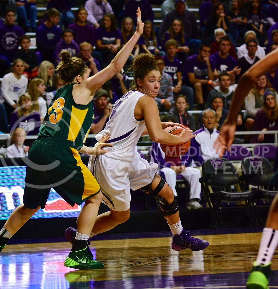 (Photo by Parker Robb | Collegian)<br /> <br /> Redshirt senior forward Katya Leick charges past an Alaska-Anchorage defender during the Wildcats' exhibition game against the University of Alaska-Anchorage Seawolves November 1, 2013 in Bramlage Coliseum. After clawing back from a sixteen-point deficit, the Wildcats defeated the Seawolves 73-65.