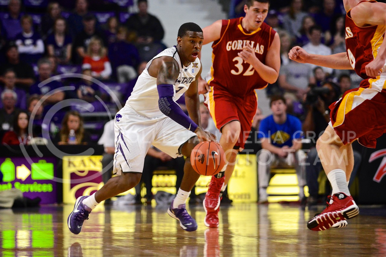 (Photo by Parker Robb | Collegian)<br /> <br /> Freshman guard Marcus Foster dribbles around two Pittsburg State defenders during the Wildcats' 75-54 exhibition win over the Gorillas November 1, 2013, in Bramlage Coliseum. Freshmen Foster, Wesley Iwundu and Nigel Johnson combined for 38 of the team's 75 points in their first game as Wildcats.