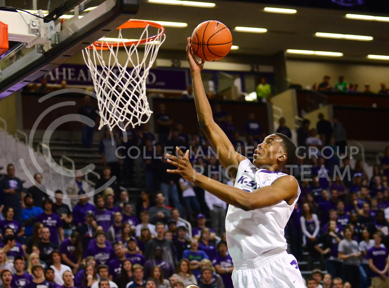 (Photo by Parker Robb | Collegian)<br /> <br /> Freshman guard/forward Wesley Iwundu soars above the court for a layup during the Wildcats' exhibition win over Pittsburg State November 1, 2013. Both the men's and women's basketball teams open their seasons with a doubleheader tonight at Bramlage, the women playing Tennessee State, followed by the men playing Northern Colorado.