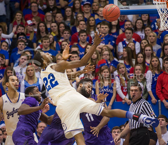 (Photo by Emily DeShazer | The Collegian)  Kansas freshman guard Andrew Wiggins fouls K-State junior forward Thomas Gipson on Jan. 11 at Allen Fieldhouse.