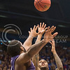 (Photo by Emily DeShazer | The Collegian)  Kansas junior guard Naadir Tharpe shoots over K-State junior forward Thomas Gipson on Jan. 11 at Allen Fieldhouse.